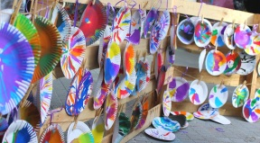 Abstract art works hanging to dry - plate spinning with paint.